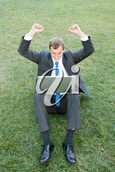 Royalty Free Photo of a Businessman Working Outdoors