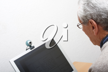 Royalty Free Photo of an Elderly Man Using a Computer