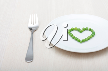 Royalty Free Photo of Heart Shape Peas on a Plate