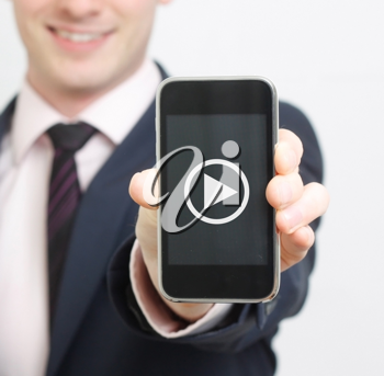 Royalty Free Photo of a Businessman Holding a Cellphone