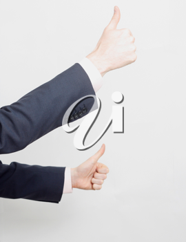 Royalty Free Photo of a Businessmen Giving Thumbs Up