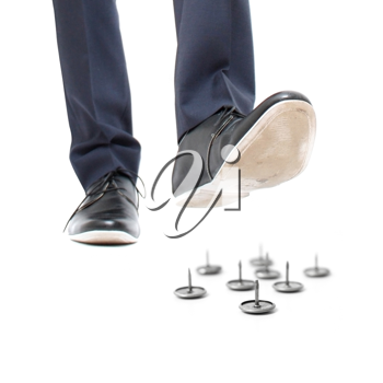Royalty Free Photo of a Businessman Stepping on Pins