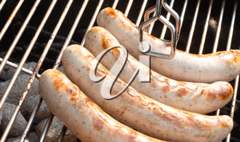Royalty Free Photo of Sausage on a Barbecue