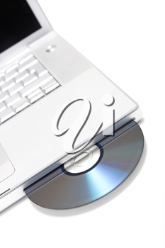 Royalty Free Photo of a CD in a Laptop