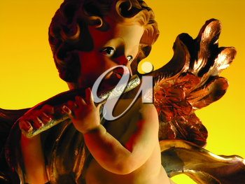 Royalty Free Photo of an Angel Figurine With a Flute