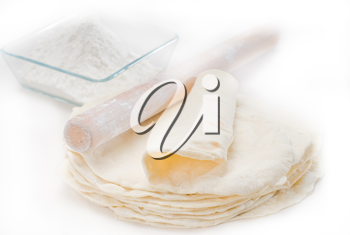 making fresh homemade pita bread ,with ingredients overa table