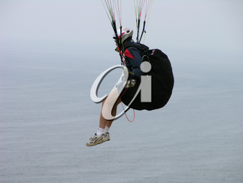 Royalty Free Photo of a Paraglider Suspended in the Air