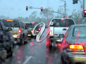 Royalty Free Photo of Cars Driving in the Rain