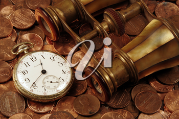 Royalty Free Photo of a Pocket Watch and Coins