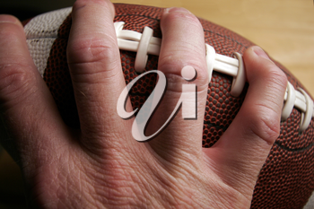 Royalty Free Photo of a Person Holding a Football