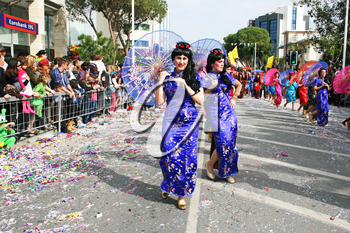 Royalty Free Photo of People Wearing Costumes Performing in a Parade