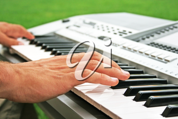 Royalty Free Photo of a Musician Playing the Piano