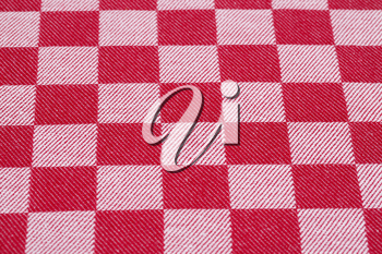 Checkered tablecloth texture as a background, closeup picture.