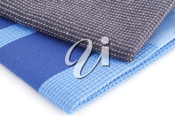 Colorful kitchen towels on white background.