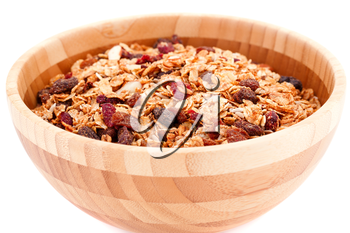 Muesli in the bowl isolated on white background.