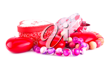 Red heart candles, necklaces and gift boxes isolated on white background.