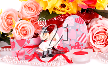 Colorful roses, bride and fiance, candle and gift box close up picture.