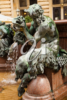 The figurine at the statue of Hygieia the goddess of health and hygiene n the courtyard of Hamburg City Hall (Rathaus), Germany.
