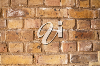 The texture of the brown bricks wall as a background.