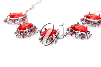 Stylish necklace with red stones isolated on a white background.