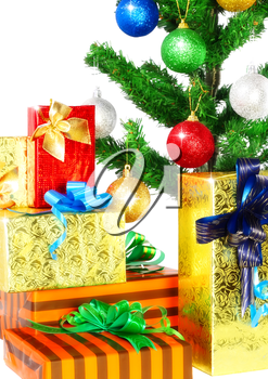 Fragment of Christmas and New Year Tree with gift boxes. Isolated over white background.