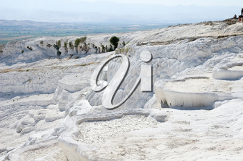 Limy cascades of flowing down water in Turkey. Pamukkale