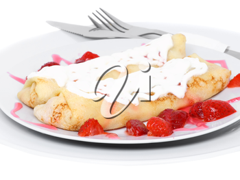 Pankcake with cream , with rolled fruit inside and strawberry around. Isolated