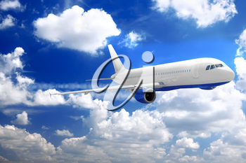 Modern airplane in a sky with clouds.