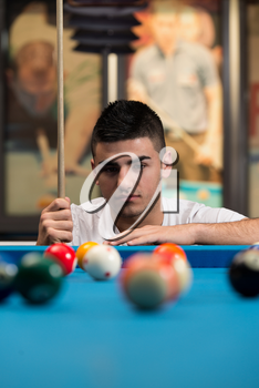 Portrait Of A Young Man Concentration On Ball