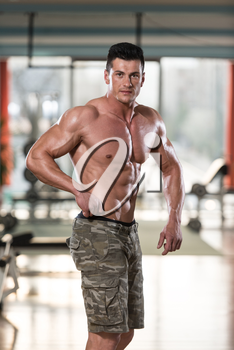 Portrait Of A Physically Fit Young Man In Modern Fitness Center