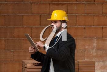 Portrait Of Construction Master With Personal Computer In Hands