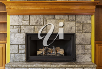 Natural Gas Insert Fireplace built with stone and wood