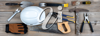 Labor Day holiday background with rustic wood and various worker tools
