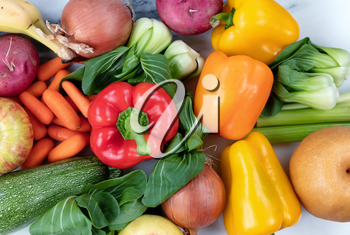 Close up top view of raw organic vegetables and fruits for healthy diet concept