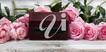 Close up of a cremation funeral box with rose flowers for death concept from Coronavirus or COVID-19