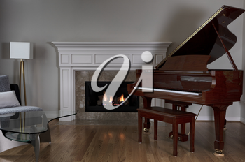 Glowing fireplace with baby grand piano on solid red oak floors