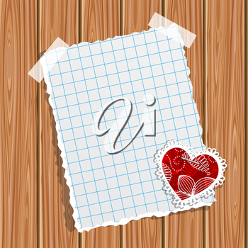 Blank notebook paper and small valentine on a wooden wall