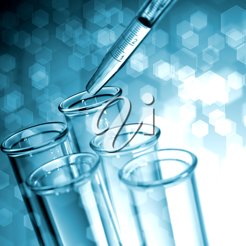 Pipette Adding Fluid to One of Several Test Tubes. Medical Background.