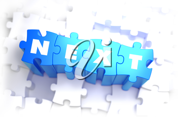 Next - Text on Blue Puzzles on White Background. 3D Render.