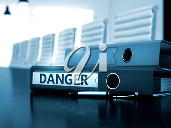 Office Binder with Inscription Danger on Office Wooden Desktop. Danger - Illustration. Danger - Office Binder on Office Wooden Desktop. Danger - Business Concept on Blurred Background. 3D Render.