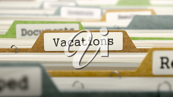 Vacations on Business Folder in Multicolor Card Index. Closeup View. Blurred Image.