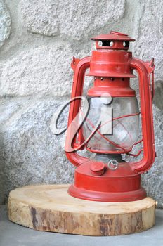 Old red lantern against a stone wall