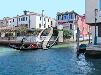 Gondolier On Grand Canal, gondola in movement on Grand Canal in Venice, Italy