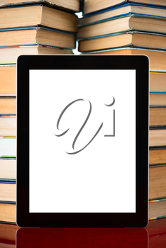 tablet pc with blank screen on a book background