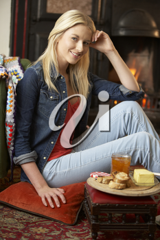 Young woman making toast on open fire
