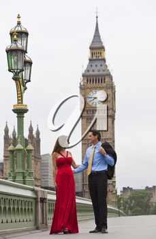 Romantic man and woman couple on Westminster Bridge with Big Ben in the background, London, England, Great Britain