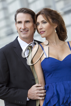 Successful and happy man and woman couple in smart clothes.