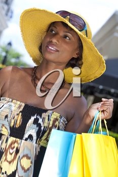 Beautiful and fashionable African American woman with colorful shopping bags