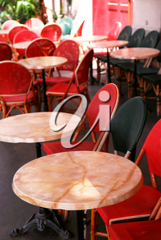 Colorful tables and chairs in sidewalk cafe. Paris, France.
