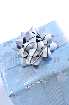Wrapped christmas gift box close up on white background